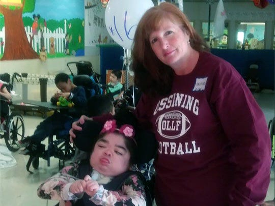 Elizabeth Poulos, left, celebrates her 16th birthday in a party earlier this year with her mom, Kristine Deleg of Ossining, New York, at the Wanaque Center for Nursing and Rehabilitation in Haskell, New Jersey.