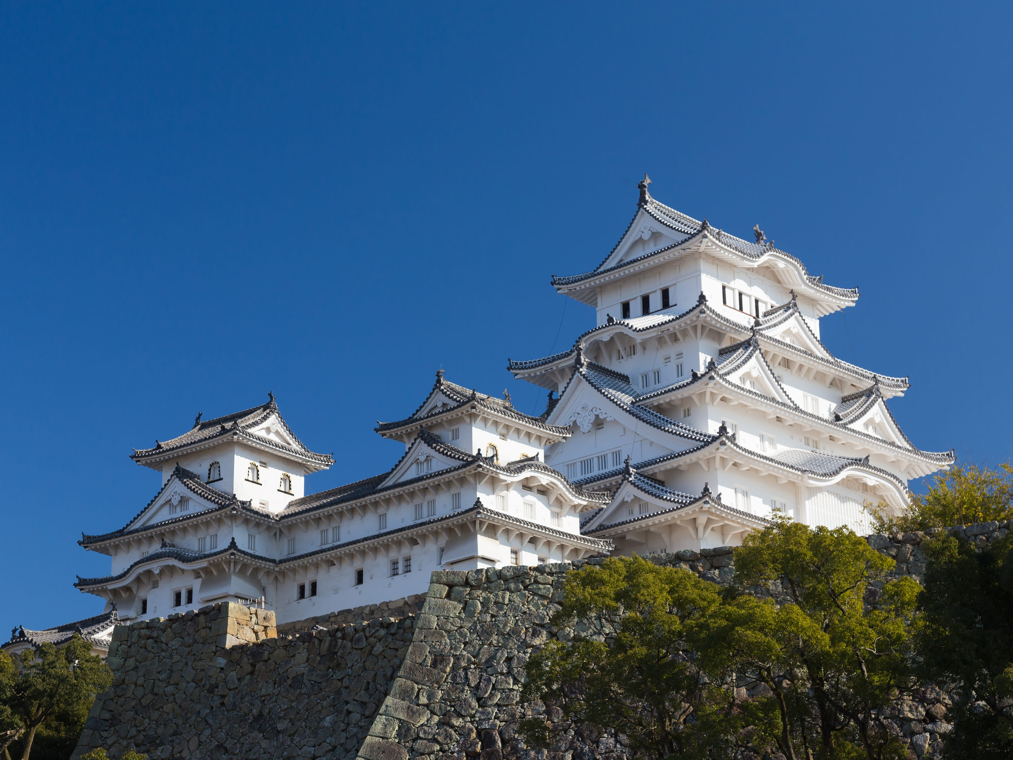 Himeji Castle in Himeji, Japan: From Kyoto, you can take a day trip to visit the most beautiful castle in Japan — Himeji Castle. With five stories of elegant decoration and exquisite details, this castle is a remarkable sight rising above the horizon.