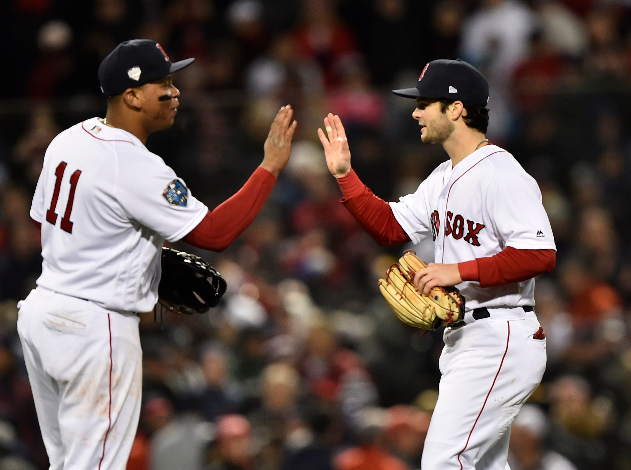 Game 2 at Fenway Park: Rafael Devers and Andrew Benintendi celebrate after the 4-2 win.