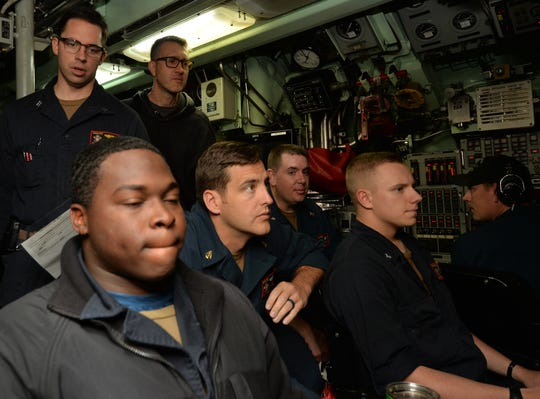 """""""Hunter Killer"""" director Donovan Marsh (back right) looks on from the control room with the crew of the USS Annapolis."""
