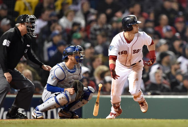 Red Sox outfielder Andrew Benintendi delivers a single in the fifth inning.