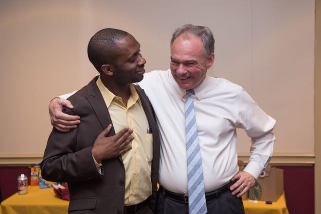 Clemson alum Tyrone Gayle with Virginia Senator Tim Kaine. Kaine officiated at Gayle's wedding in May.