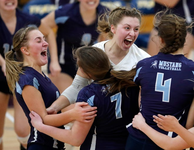 Little Chute's Gabi Roemer, Katherine Joten, Emma Ciske, and Hannah VandenBerg celebrate after defeating Xavier in a WIAA Division 2 girls volleyball semifinal match Thursday in Chilton.
