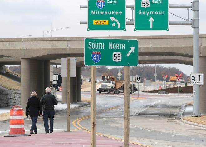 Attendees take a walk on the newly constructed roundabout following a ribbon cutting Friday near the I-41/State 55 interchange in Kaukauna. Wm. Glasheen/USA TODAY NETWORK-Wisconsin.