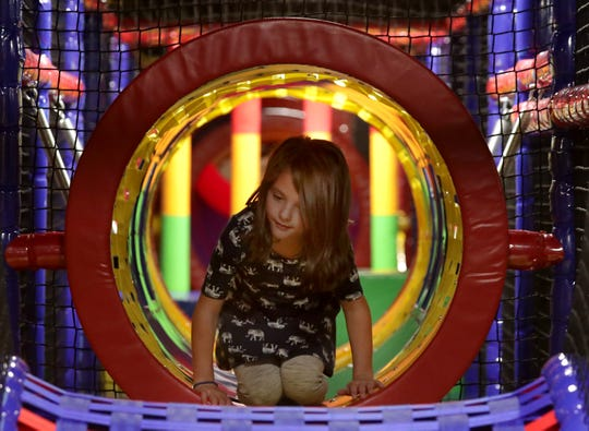 "Alana Schulte crawls through a tunnel during ""friends and family night"" at Luv 2 Play in Grand Chute."