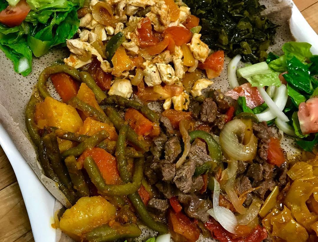 At Ada's Gojjo, an Ethiopian dish of chicken and beef served with potatoes, carrots and green beans, split yellow peas, lentils and collard greens.