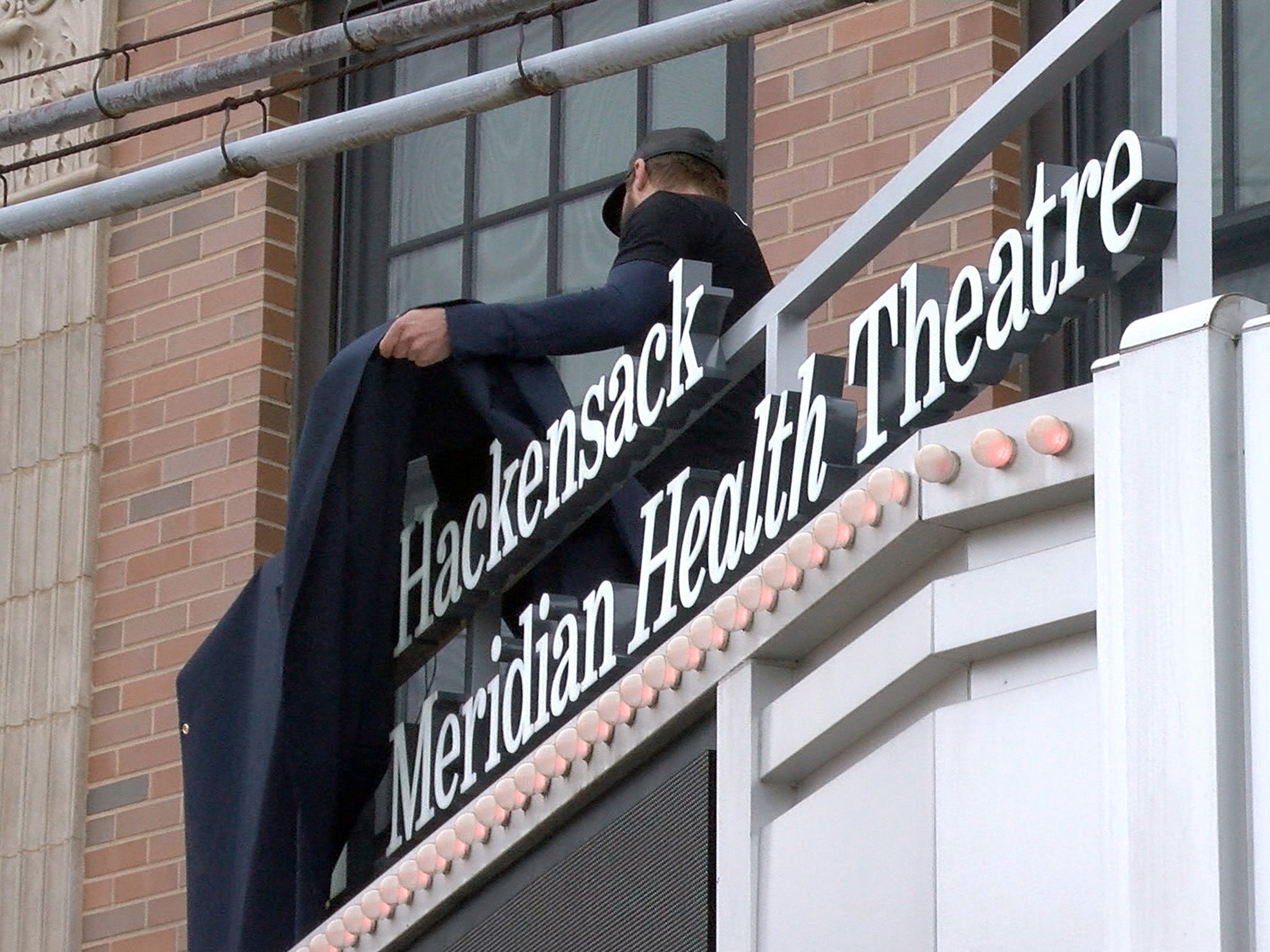 The wraps are removed to announce a new partnership between the Count Baise Theatre for the Arts in Red Bank and Hackensack Meridian Health Friday, October 26, 2018.
