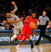 Georgetown Hoyas guard Jagan Mosely (4) fouls St. John's Red Storm guard Shamorie Ponds (2) during second half of first round game in Big East Tournament at Madison Square Garden.