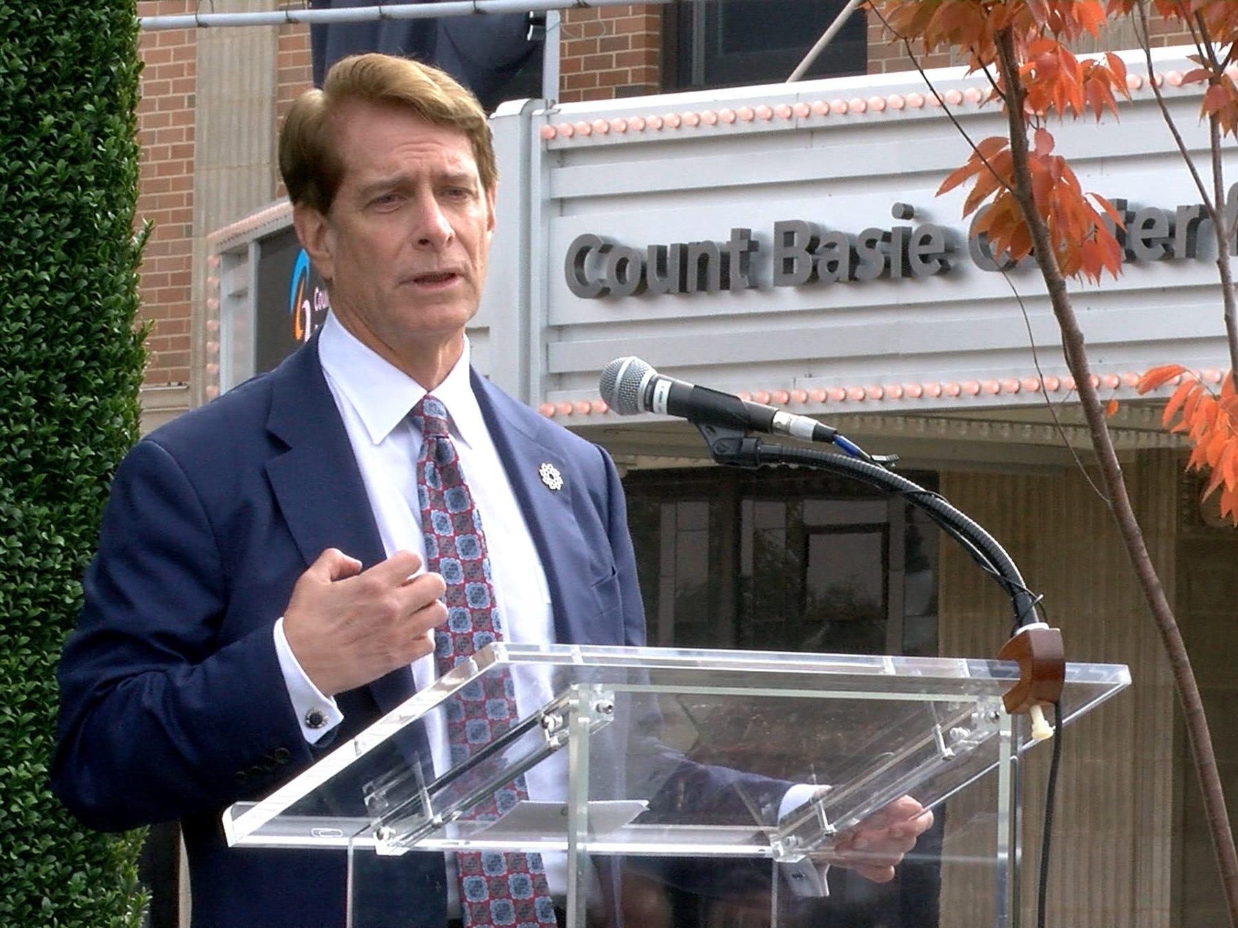 Hackensack Meridian Health Co-CEO Robert C. Garrett speaks about the new partnership with the Count Baise Theatre for the Arts during a ceremony Friday, October 26, 2018, in Red Bank.
