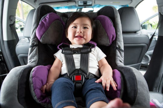 Baby sitting in car seat, ready to go for a ride!