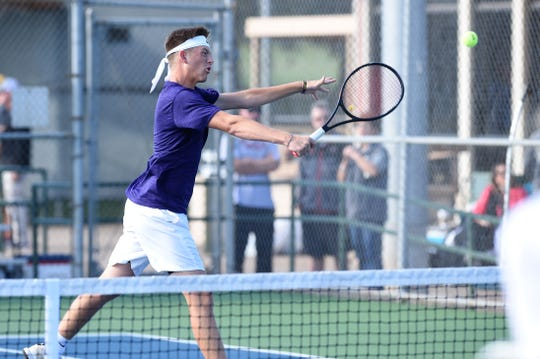 Wylie's Davyn Williford hits a shot at the net during the No. 1 boys doubles match in the Region I-5A final against Amarillo High at the Hamilton Park Tennis Center in Wichita Falls on Friday, Oct. 26, 2018. Williford and Lane Adkins won in three sets.