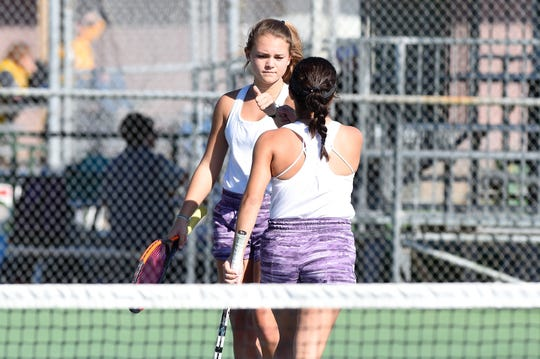 Wylie's Leighton Alford, left, and Analeah Elias fist bump during the No. 1 girls doubles match in the Region I-5A final against Amarillo High at the Hamilton Park Tennis Center in Wichita Falls on Friday, Oct. 26, 2018. The pair won 6-3, 6-4.