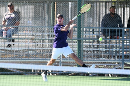 Wylie's Lane Adkins hits a shot during the No. 1 boys doubles match in the Region I-5A finals on Friday, Oct. 26, 2018.