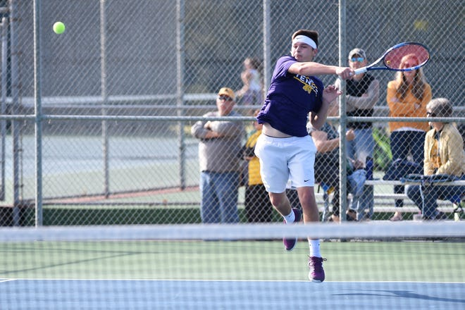 Wylie's Aric Richardson hits a shot during the No. 2 boys doubles match in the Region I-5A final at Hamilton Park in Wichita Falls on Friday, Oct. 26, 2018. Richardson and Cole Edwards won in three sets as the Bulldogs led 5-2 after doubles.