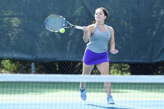 Wylie's Analeah Elias hits a shot during the No. 1 girls doubles match in the Region I-5A semifinals against Colleyville Heritage at the Weeks Park Tennis Center in Wichita Falls on Thursday, Oct. 26, 2018. The Bulldogs won 16-1 to advance to Friday's final.
