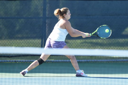 Wylie's Hailey Parker reaches for a backhand shot during the No. 3 girls doubles match in the Region I-5A final against Amarillo High at the Hamilton Park Tennis Center in Wichita Falls on Friday, Oct. 26, 2018. Parker and Madison Andrews won 6-0, 6-0.