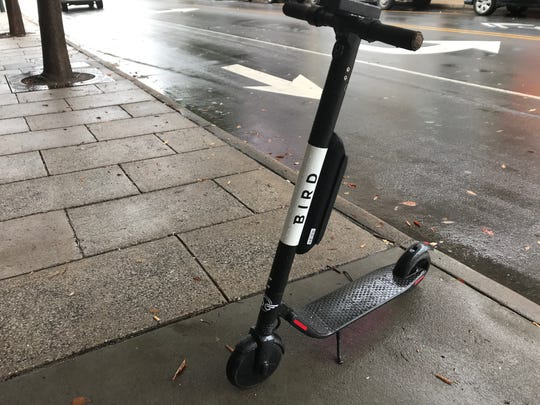 A Bird electric scooter is parked on Patton Avenue near Pritchard Park Oct. 26 in Asheville. The scooter company launched a fleet in downtown Asheville Oct. 25.