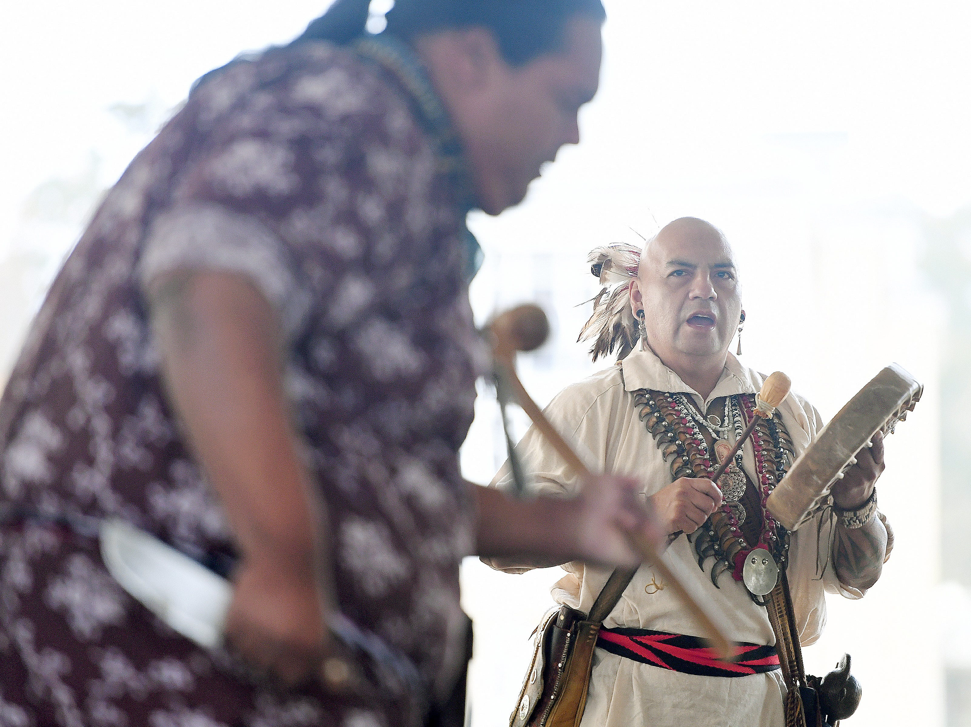 Jarrett Wildcat, left, and Sonny Ledford, with the Museum of the Cherokee Indian, perform a warrior dance during a ceremony celebrating the opening of the Veterans Hope and Recovery Center on the campus of the Charles George VA Medical Center on Oct. 26, 2018.