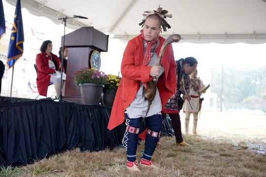 Mike Crowe, with the Museum of the Cherokee Indian, performs a warrior dance during a ceremony celebrating the opening of the Veterans Hope and Recovery Center on the campus of the Charles George VA Medical Center on Oct. 26, 2018.
