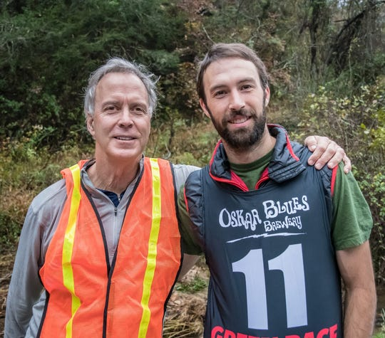 Marc Hunt, left, stands with his son, Colin Hunt, as Colin prepares for the Green River Race in Polk County last year.