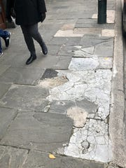 The 30-plus-year-old bluestone sidewalks on Haywood Street have been cracking for years, posing a tripping hazard. The city has patched them with concrete, which often cracks, too, and most recently with asphalt.