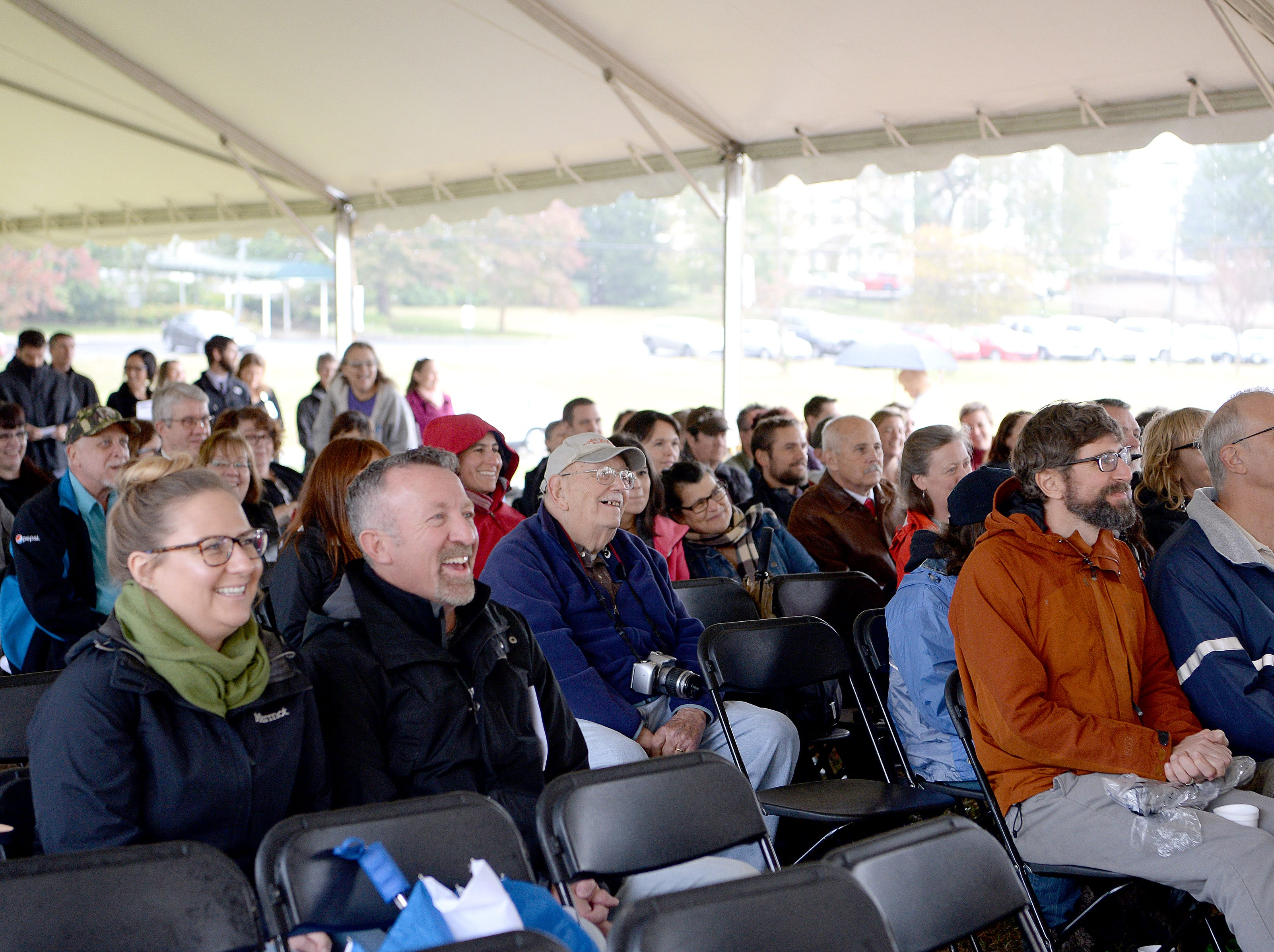 The crowd laughs as the many things the building now housing the Veterans Hope and Recovery Center on the campus of the Charles George VA Medical Center has been used as, including a haunted house, are listed during a ceremony celebrating its opening on Oct. 26, 2018.