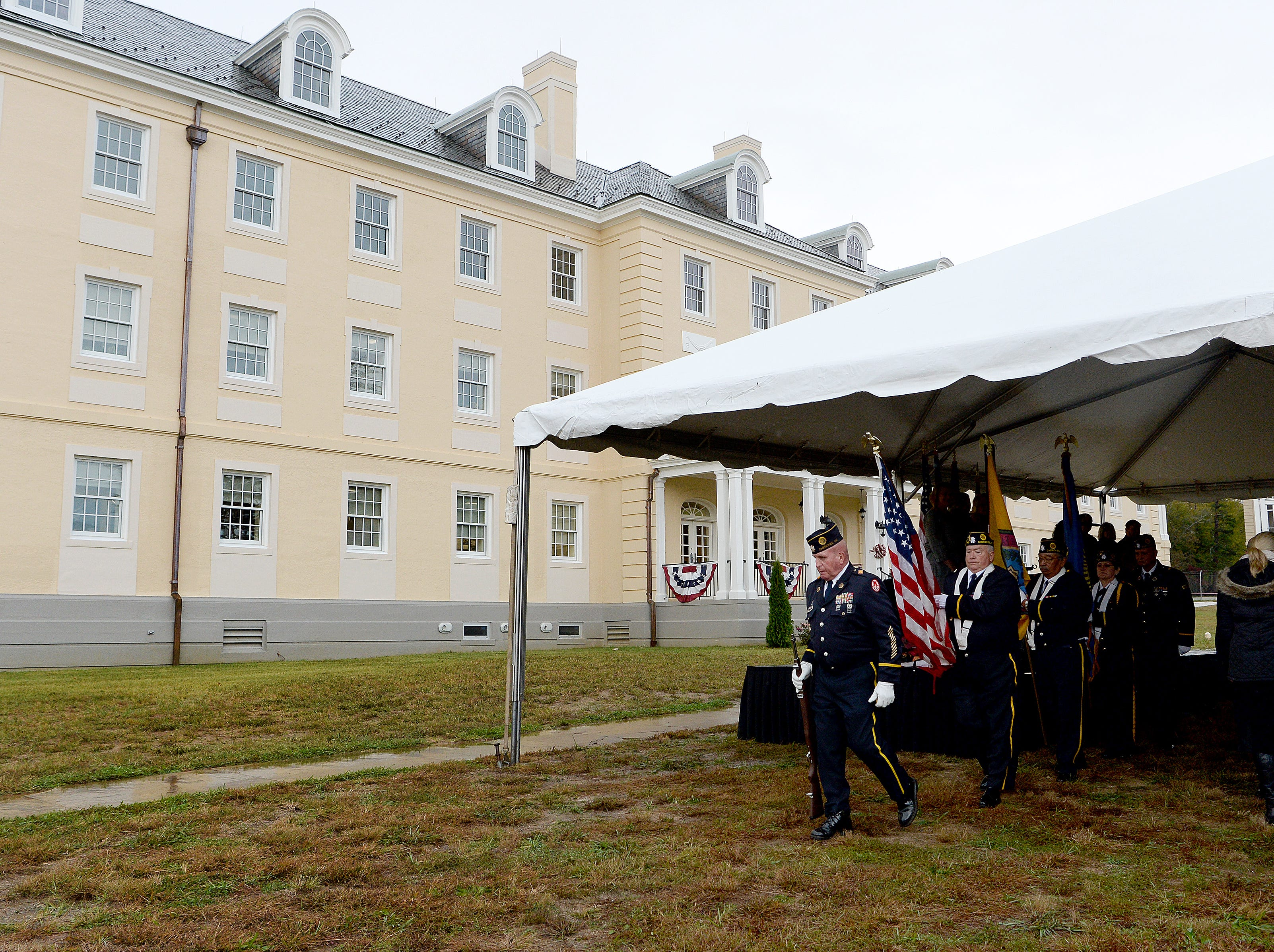 Members of the American Legion Steve Youngdeer Post 143 exit the event tent after presenting the colors during a ceremony celebrating the opening of the Veterans Hope and Recovery Center on the campus of the Charles George VA Medical Center on Oct. 26, 2018.