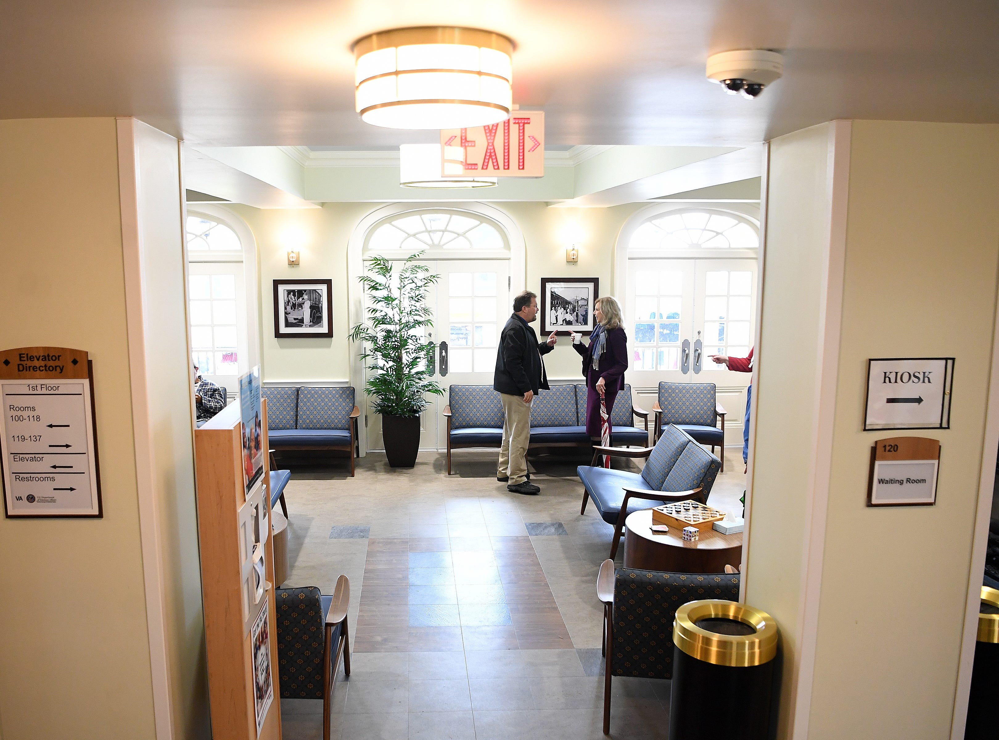 Visitors tour the Veterans Hope and Recovery Center on the campus of the Charles George VA Medical Center following a ribbon cutting ceremony on Oct. 26, 2018. The building was originally opened as a dormitory for nurses in the 1930s and was eventually condemned before being remodeled and reopened officially on Friday.