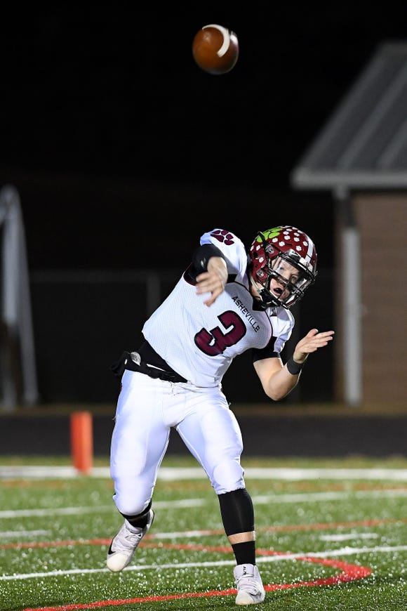 Asheville quarterback Three Hillier throws a pass during their game at North Buncombe High School on Oct. 25, 2018. The Cougars defeated the Blackhawks 28-19.