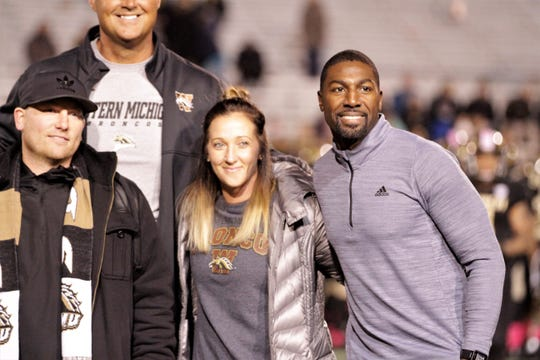 Becky Horn (track and field) and Greg Jennings (football) pose during their induction ceremony into the Western Michigan University Athletic Hall of Fame at Waldo Stadium in Kalamazoo on Thursday, October 25, 2018.