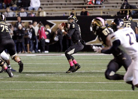Western Michigan quarterback Kaleb Eleby (9) prepares to throw a 62-yard touchdown pass to receiver Jayden Reed (87) in a game against Toledo at Waldo Stadium in Kalamazoo on Thursday, October 25, 2018.