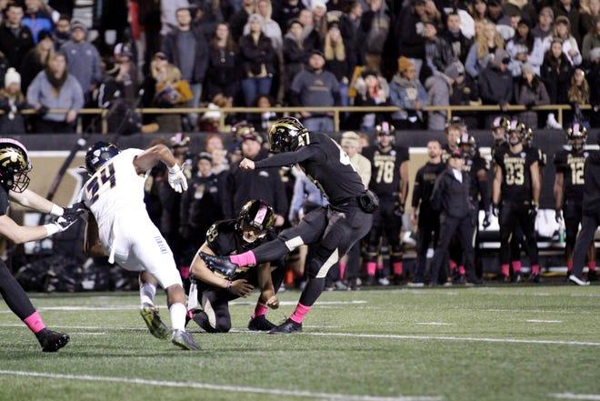 In this 2018 photo, Western Michigan kicker Gavin Peddie (47) kicks against Toledo at Waldo Stadium in Kalamazoo.