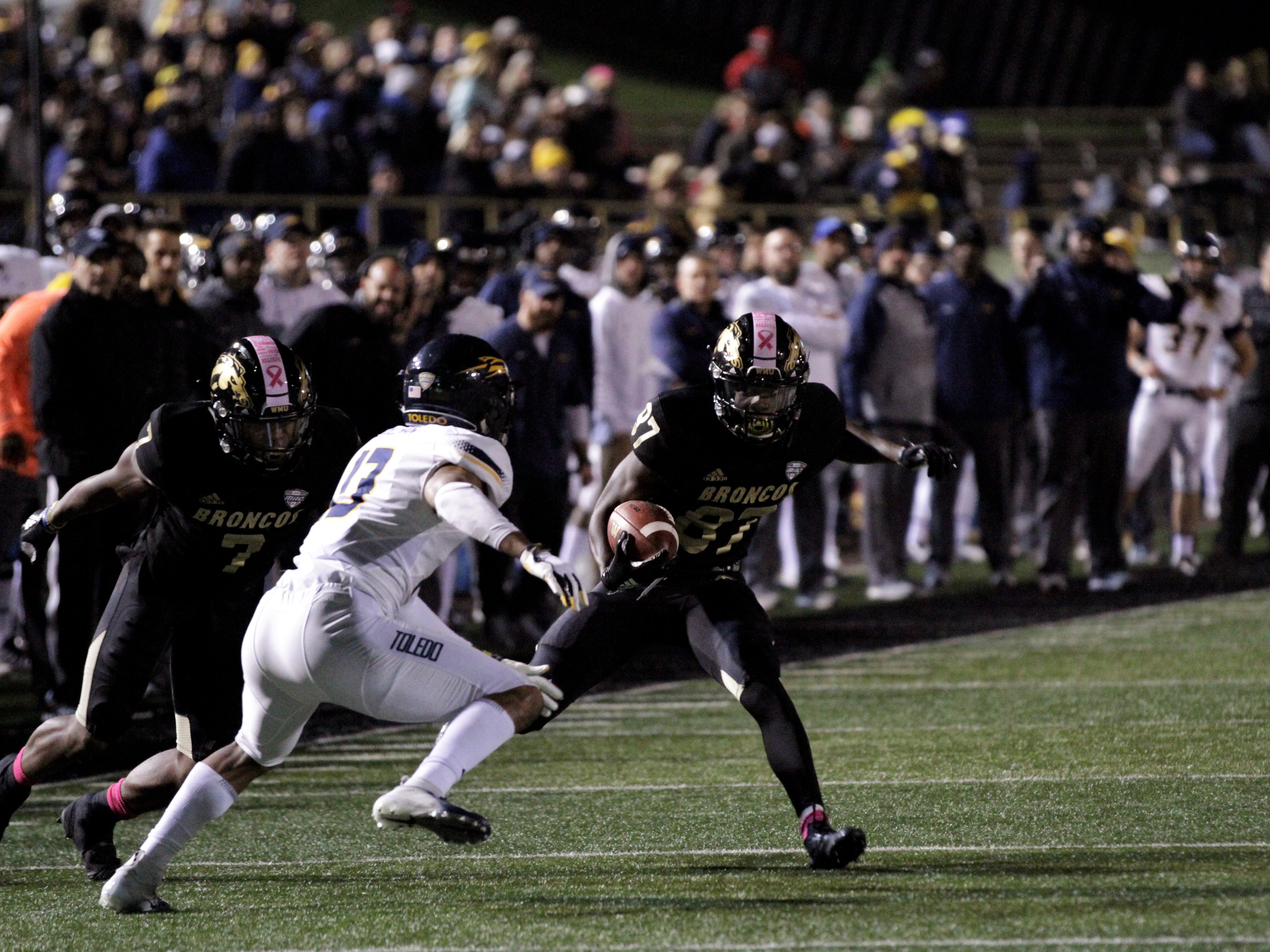Western Michigan wide receiver Jayden Reed (87) cuts inside Toledo safety Ka'Dar Hollman (13) on his way to a 25-yard touchdown at Waldo Stadium in Kalamazoo on Thursday, October 25, 2018.