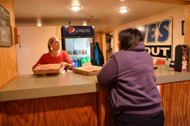 Steve's Pizza in Battle Creek has seen an influx of customers since the story of one of its managers, Dalton Shaffer, delivering a pizza to a cancer patient in Indianapolis gained national attention.