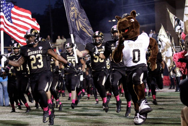 Buster Bronco and the Western Michigan Broncos take the field before their game against Toledo at Waldo Stadium in Kalamazoo on Thursday, October 25, 2018.