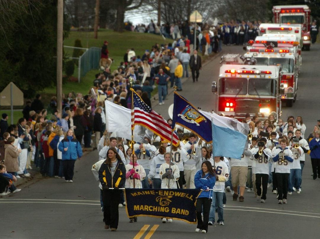 In 2004, the parade led by the Maine-Endwell High School Marching Band and fire apparatus from Endwell Fire Department leads the members of the state championship football and field hockey teams down Farm to Market Road.