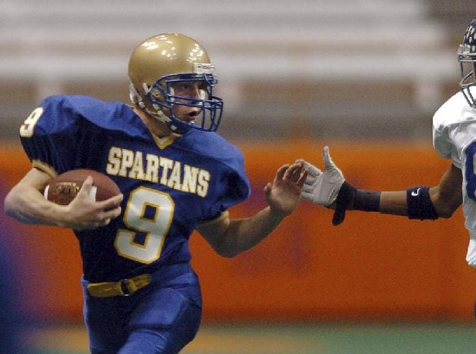 In 2004, Maine-Endwell's Shawn Fitchpatrick, left, is chased by Whitesboro's Derrick Woodard during their Class A football game at the Carrier Dome November 13, 2004.