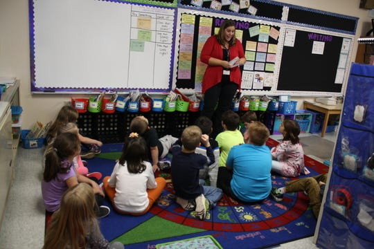 Chenago Forks Elementary School teacher Jessica McBreen teaches the fundamentals of reading to her second grade classroom on Oct. 26.