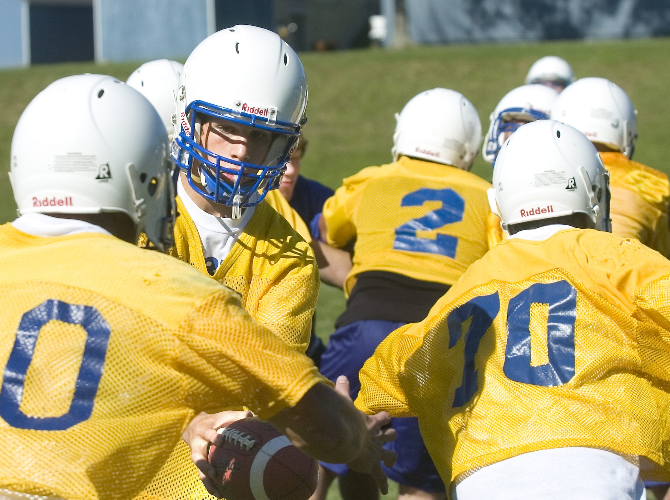 Maine-Endwell High School quarterback Joe Battaglini hands off to a running back during practice in 2006.