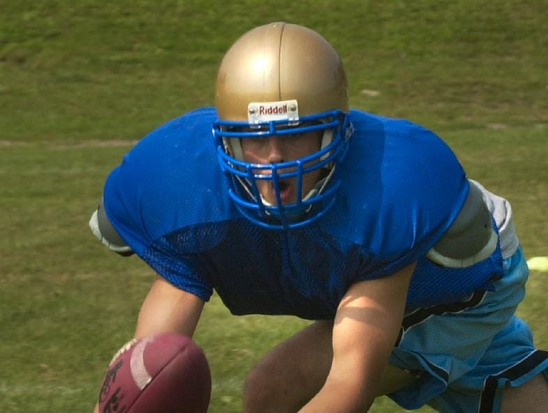 In 2003, Maine-Endwell end Luke Visingard takes in a pass from quarterback Shane Connolly during practice.