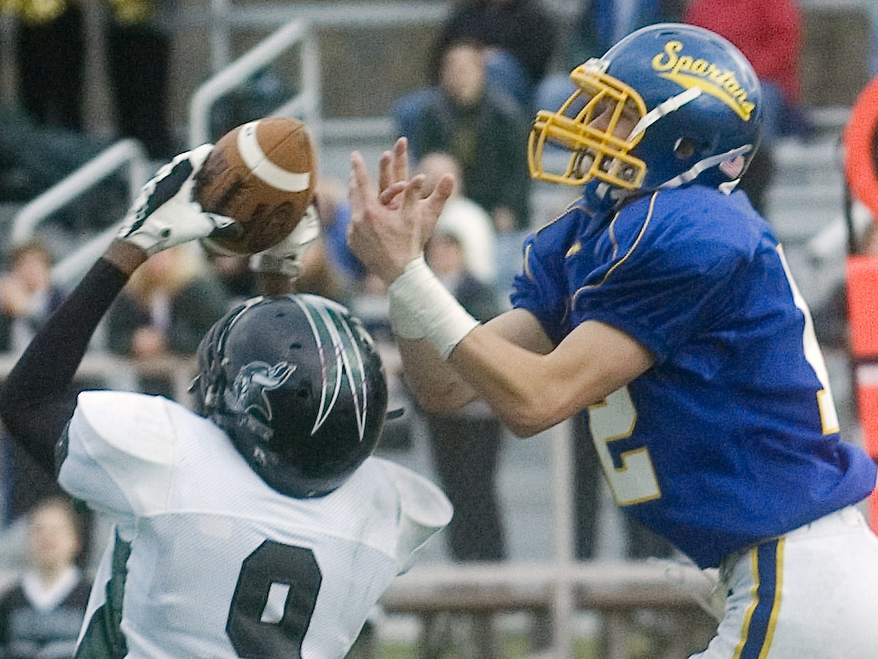 Corning West's D.J. Veasey, left, picks of what would have been the go-ahead touchdown pass intended for Maine-Endwell's Tom Connolly in the fourth quarter of a 2008 game at Ty Cobb Stadium.