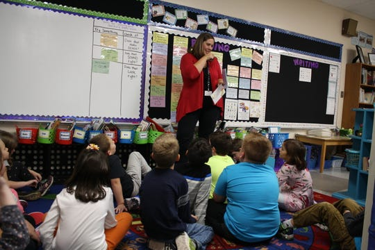 Chenago Forks Elementary School teacher Jessica McBreen gives a reading lesson to her second-grade students on Oct. 26.