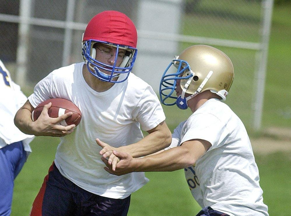 Joe Frieser, left, tries to get past Josh Wright, right, during an offensive drill during Maine-Endwell's first official varsity football practice in 2001.