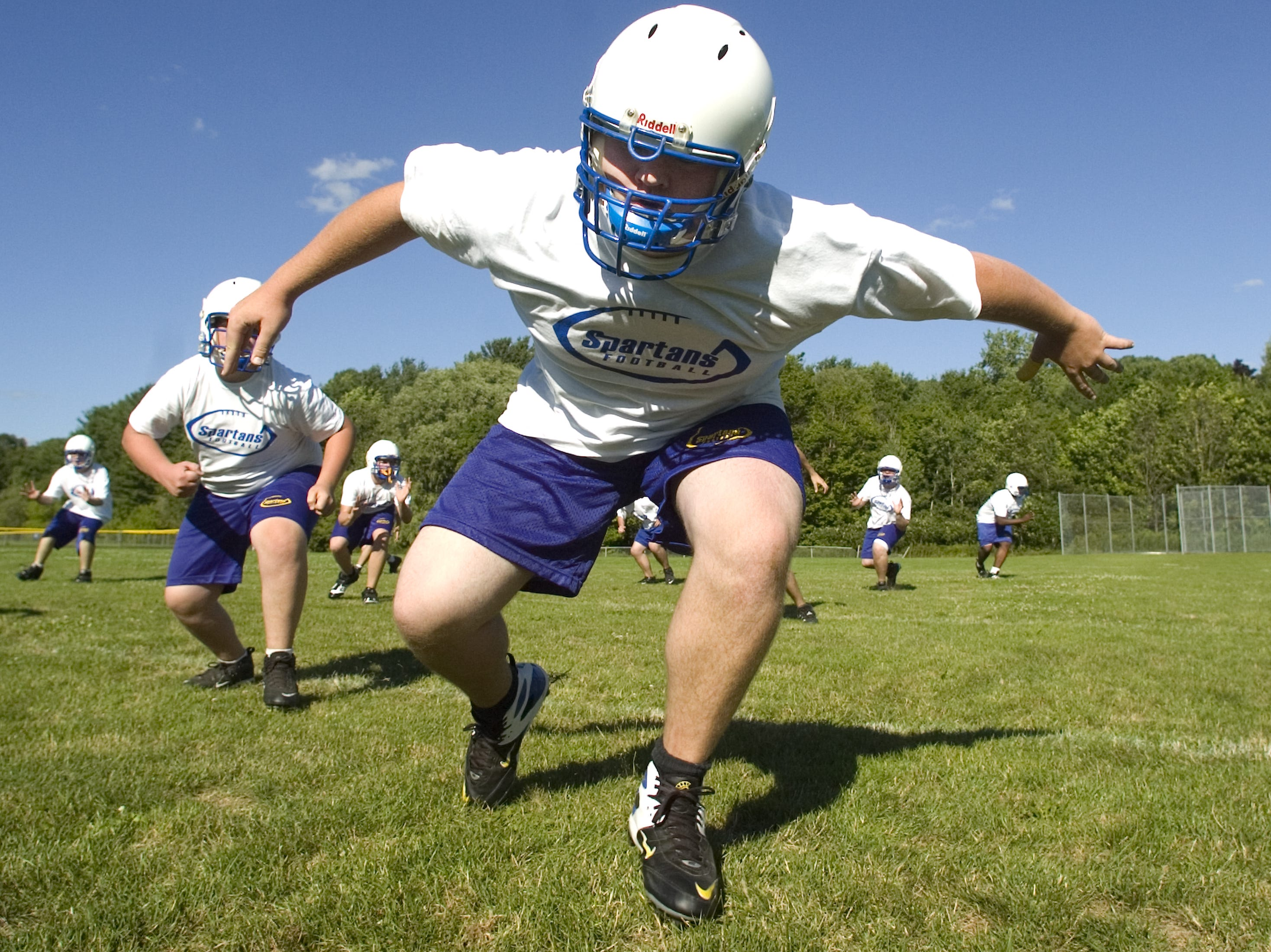 Senior Pat Rutkowski completes a defensive drill during the first day of Maine-Endwell High School's football practice Monday in Endwell. 2005