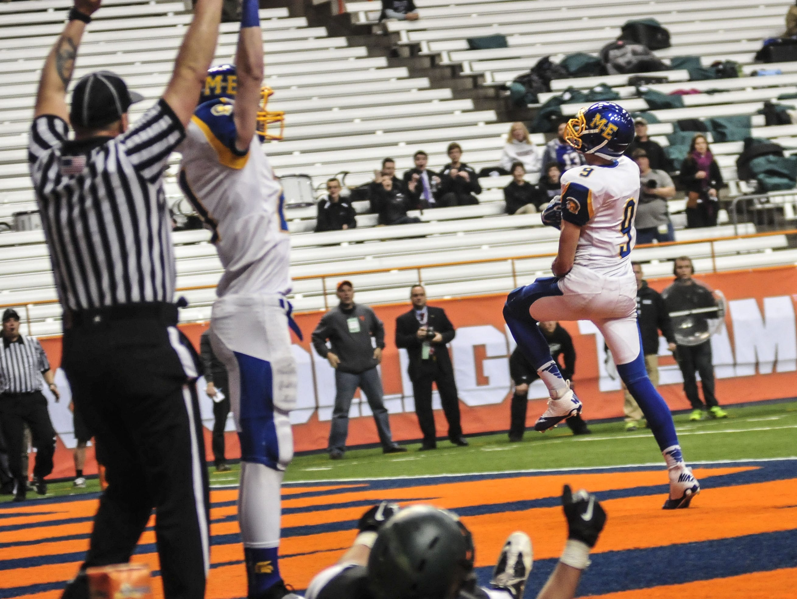 Maine-Endwell's Kyle Gallagher targets Jake Sinicki in the end zone to bring the score to 20-21 against Schalmont Endwell during the 2013 New York State Public High School Athletic Association Football Class B Championship at the Carrier Dome in Syracuse.
