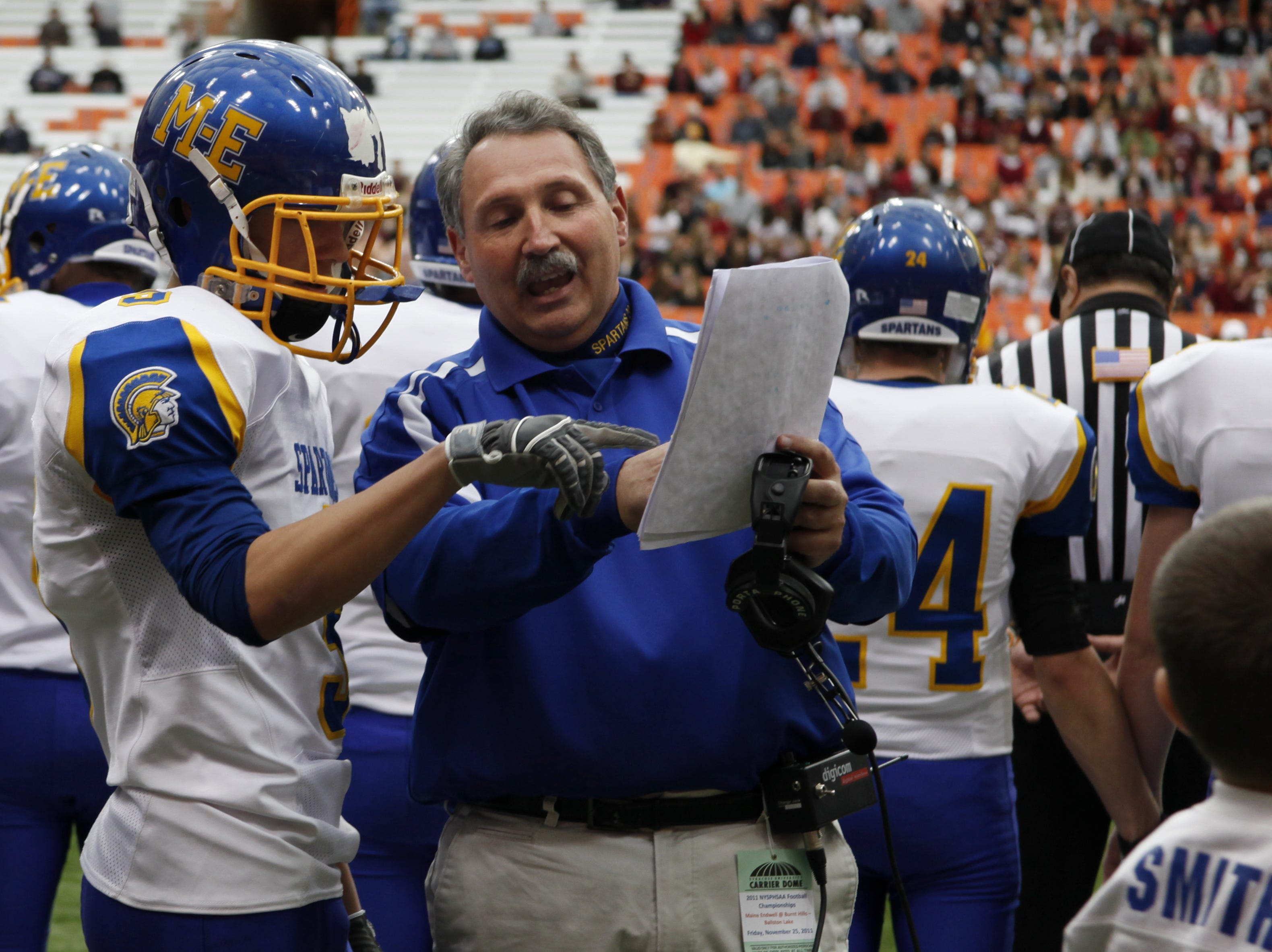 Maine Endwell's Coach Gary Crooks takes a minute to review with Robert Allen before the start of the Class A New York State High School Football Championship held in Syracuse's Carrier Dome.