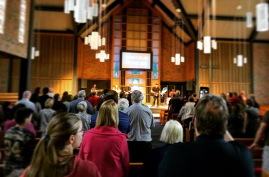 Members of Foundation Church listen to music at the church. The church offers contemporary music and worship services.