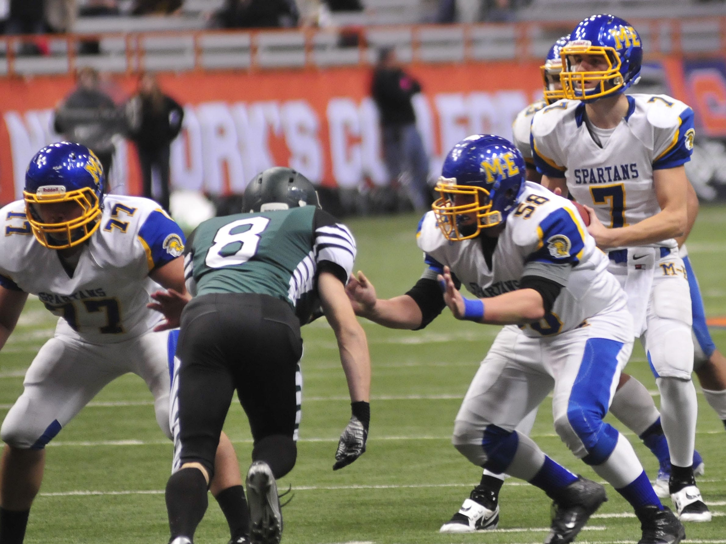 Maine-Endwell's Matt Brozovic protects Kyle Gallagher from Schalmont's Nicholas Langenbach during the 2013 New York State Public High School Athletic Association Football Class B Championship at the Carrier Dome in Syracuse.