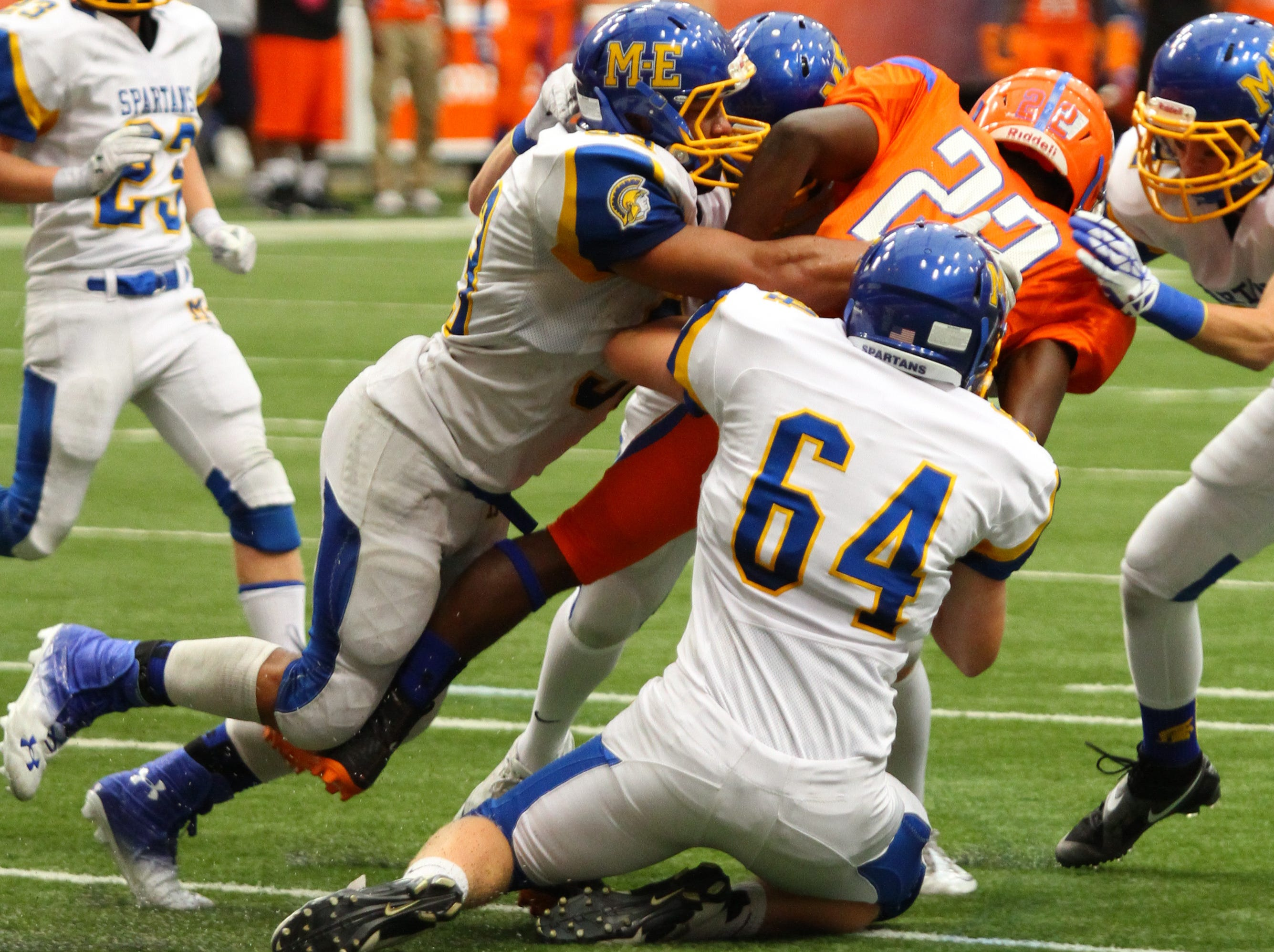 Maine-Endwell's Hunter Hazen makes the initial hit as a swarm of M-E defenders help out in a 2013 game against Nottingham.