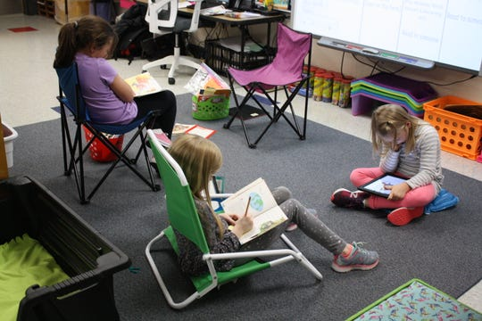 Students in Jessica McBreen's second-grade classroom use a flexible seating arrangement while completing reading assignments on Oct. 26.